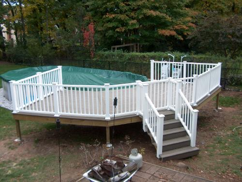 Pool deck with slide above ground pool decks pinterest pool decks decks and pools - Above ground composite pool deck ...
